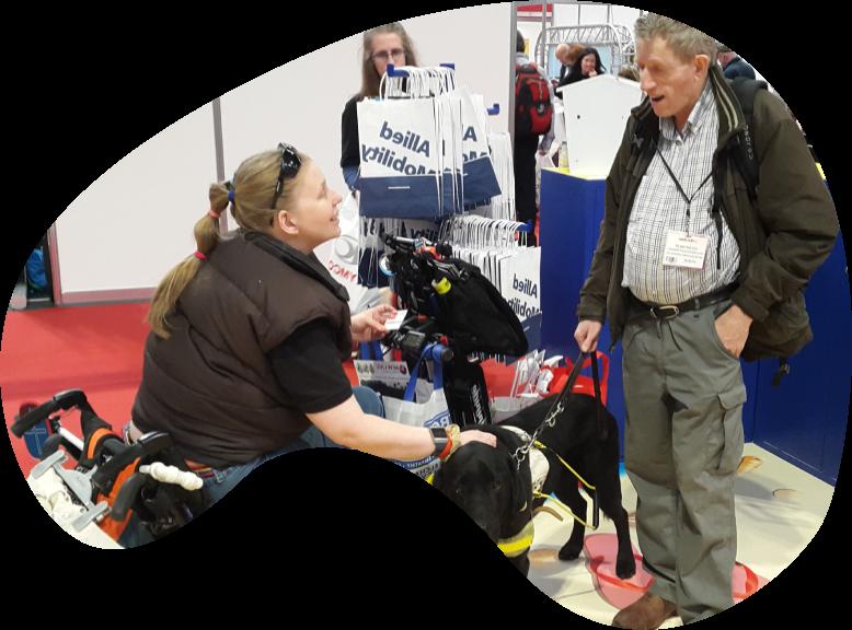 A man and a woman talking at Nadex 45 tradeshow